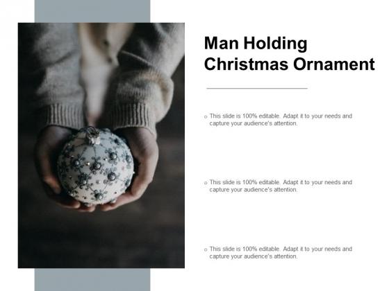 Man Holding Christmas Ornament Ppt PowerPoint Presentation Portfolio Brochure