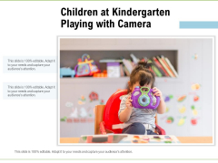 Children At Kindergarten Playing With Camera Ppt PowerPoint Presentation Styles Format PDF