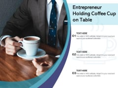 Entrepreneur Holding Coffee Cup On Table Ppt PowerPoint Presentation Gallery Outline PDF
