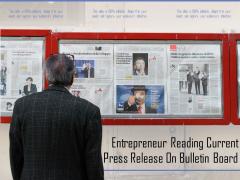 Entrepreneur Reading Current Press Release On Bulletin Board Ppt PowerPoint Presentation Outline Maker PDF