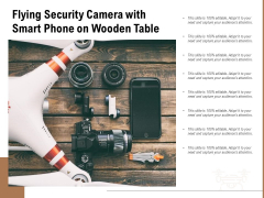 Flying Security Camera With Smart Phone On Wooden Table Ppt PowerPoint Presentation File Topics PDF