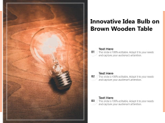 Innovative Idea Bulb On Brown Wooden Table Ppt PowerPoint Presentation File Inspiration PDF