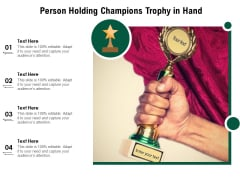 Person Holding Champions Trophy In Hand Ppt PowerPoint Presentation Outline Template PDF