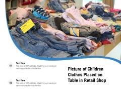 Picture Of Children Clothes Placed On Table In Retail Shop Ppt PowerPoint Presentation Slides Images PDF