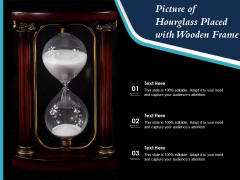 Picture Of Hourglass Placed With Wooden Frame Ppt PowerPoint Presentation Gallery Layout Ideas PDF