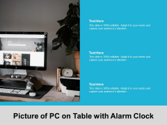 Picture Of PC On Table With Alarm Clock Ppt Powerpoint Presentation Portfolio Samples