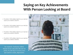 Saying On Key Achievements With Person Looking At Board Ppt PowerPoint Presentation File Graphic Tips PDF