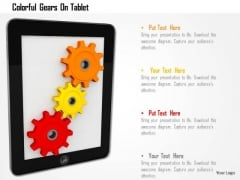 Stock Photo Colorful Gears On Tablet PowerPoint Slide
