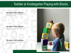 Toddler At Kindergarten Playing With Blocks Ppt PowerPoint Presentation Layouts Graphics Download PDF