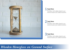 Wooden Hourglass On Ground Surface Ppt PowerPoint Presentation Icon Gallery PDF